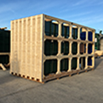 One completed heavy-duty wooden machine base crate, and one undergoing construction. Each designed to safely carriage 10 tonne air filters.