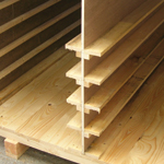 Softwood case partitioned and shelved for car panels